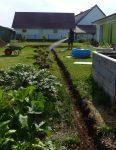 Rohrgraben und Betonberieselung